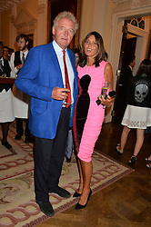 COUNT & COUNTESS LEOPOLD VON BISMARCK at a party hosed by the US Ambassador to the UK Matthew Barzun, his wife Brooke Barzun and editor of UK Vogue Alexandra Shulman in association with J Crew to celebrate London Fashion Week held at Winfield House, Regent's Park, London on 16th September 2014.