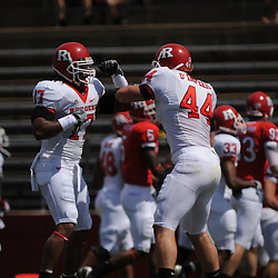 Apr 18, 2009; Piscataway, NJ, USA; Rutgers' LBs Damaso Munoz (17) and Ryan D'Imperio (44) get pumped up prior to Rutgers' Scarlet and White spring football scrimmage.