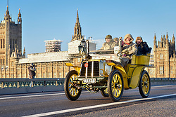 © Licensed to London News Pictures. 05/11/2017. London, UK.  Participants cross Westminster Bridge en route to the coast in the 121st Bonhams London to Brighton Veteran Car Run.  The 60 mile journey is undertaken by 400 pre-1905 manufactured vehicles, some of which suffer frequent breakdowns.  The Run commemorates the Emancipation Run of 14 November 1896, which celebrated the Locomotives on the Highway Act, when the speed limit for 'light locomotives' was raised from 4 mph to 14 mph, abolishing the need for vehicles to be preceded by a man on foot.   Photo credit: Stephen Chung/LNP