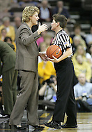 25 JANUARY 2007: Iowa head coach Lisa Bluder talks things over with a referee in Iowa's 80-78 overtime loss to Minnesota at Carver-Hawkeye Arena in Iowa City, Iowa on January 25, 2007.
