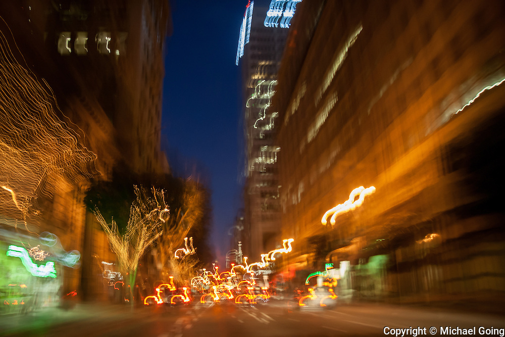 Light streaks and light trails of downtown Los Angeles city street at twilight. Motion blur, slow shutter