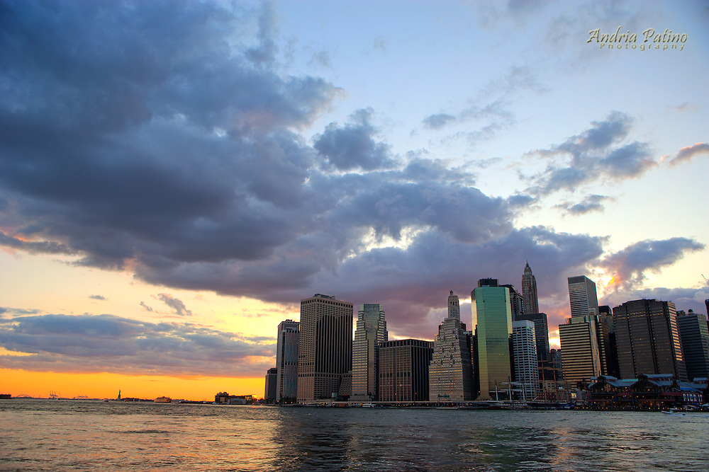 Sunset behind the Downtown Manhattan Skyline and the New York Harbor