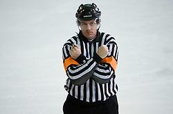 Znak za oviranje. Interference. Slovenski hokejski sodnik Damir Rakovic predstavlja sodniske znake. Na Bledu, 15. marec 2009. (Photo by Vid Ponikvar / Sportida)