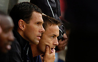 Photo: Richard Lane.<br />Swindon Town v Reading. Pre Season Friendly. 29/07/2006. <br />Swindon's new manager, Dennis Wise watches on from the bench with his assistant, Gus Poyet (L).