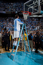 CHAPEL HILL, NC - MARCH 05: D.J. Johnston #32 of the North Carolina Tar Heels cuts down the net after defeating the Duke Blue Devils and winning the regular season ACC championship on March 05, 2011 at the Dean E. Smith Center in Chapel Hill, North Carolina. North Carolina won 67-81. (Photo by Peyton Williams/UNC/Getty Images) *** Local Caption *** D.J. Johnston