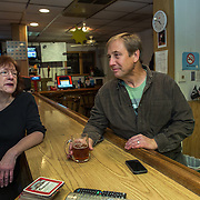 TAKOMA PARK, MD  - JAN 25: Takoma Park resident and concert organizer Pete Marra, talks with bartender and VFW Ladies Auxillary president Debbie Thomas at the VFW post in Takoma Park, Maryland, January 25, 2014. VFW Posts are dying all across the country but in the unlikely liberal haven of Takoma Park, the old VFW is showing signs of life. By throwing open the doors to private parties and concerts like the ones Marra organizes, the club is breaking even in spite of dwindling membership. Several times a month, the bar dwelling regular vets are sharing space with the bureaucrats, activists and peaceniks from the surrounding neighborhood. (Photo by Evelyn Hockstein/For The Washington Post)