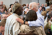 Former Vice President Joe Biden embraces Felicia and Tyrone Sanders, during a town hall meeting at the International Longshoreman's Association Hall July 7, 2019 in Charleston, South Carolina.  Felicia Sanders was a surviver of the Emanuel AME Church shooting in 2015 where nine of her fellow worshippers were murdered by a white supremacist.