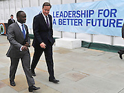© Licensed to London News Pictures. 05/10/2011. MANCHESTER. UK. The Prime Minister, David Cameron, walks with Sam Gyimah MP at The Conservative Party Conference at Manchester Central today, October 5, 2011. Photo credit:  Stephen Simpson/LNP