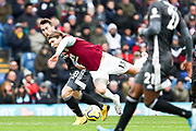Burnley midfielder Jeff Hendrick fouled by the opponent during the Premier League match between Burnley and Leicester City at Turf Moor, Burnley, England on 19 January 2020.