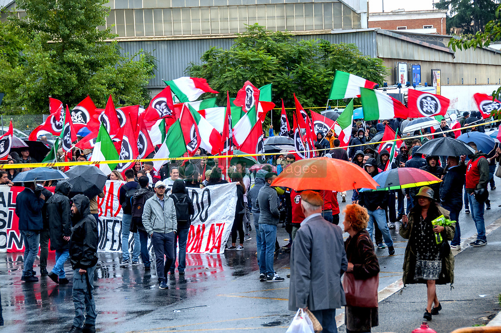October 6, 2018 - Rome, Italy, Italy - Demonstration of the extreme right movement Casapound in Rome, ''against uncontrolled immigration and against degradation''. In the days before the demonstration, numerous exponents of both the Democratic Party and the Civic Movement for Rome had asked the police station to ban the parade because this ended in the square where there was a memorial plaque commemorating the inhabitants of the district who died in World War II under the Nazi-oppression oppression. A large police force prevented the march from coming into contact with the anti-fascists who had arranged to meet in front of the tombstone. (Credit Image: © Patrizia Cortellessa/Pacific Press via ZUMA Wire)