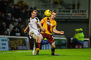 Dundee FC Defender Gary Irvine played the long ball back during the Ladbrokes Scottish Premiership match between Motherwell and Dundee at Fir Park, Motherwell, Scotland on 12 December 2015. Photo by Craig McAllister.