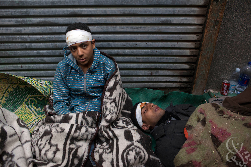 An Egyptian boy lies tired and wounded at a small field hospital inside a mosque just off Tahrir squar February 03, 2011 in cairo, Egypt. Protesters both pro and anti-Hosni  Mubarak clashed for the second day in a row, with hundreds wounded on each side.   (Photo by Scott Nelson)