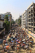Rickshaws in the crowded street of Dhaka. Traffic jam is very common in Dhaka, even if the Bangladeshi governement was trying to limit the number of licenses delivered to rickshaws owners and drivers because of the important number of rickshaws coming from the outside of Dhaka. Fake license numbers also seem to be a common practice.