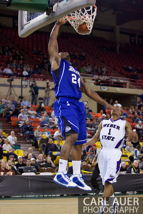 November 27th, 2010:  Anchorage, Alaska - Drake Bulldog Rayvonte Rice (24) throws down a one handed dunk in the Bulldog 81-82 loss to Weber State in the third place game of the Great Alaska Shootout.