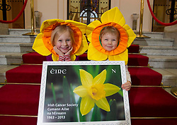 Repro Free: 21/03/2013 Alexandra (4) and Luke O'Donnell (3) from Rathgar, Co.Dublin, put their stamp of approval on the Irish Cancer Society's Daffodil Day, taking place nationwide tomorrow (Friday 22st March), pictured with a new postage stamp marking the 50th anniversary of the Irish Cancer Society, issued by An Post today.  .The Irish Cancer Society and Dell, lead partners for Daffodil Day, are calling on the Irish public to wear a daffodil today and support those affected by cancer in Ireland. Picture Andres Poveda.