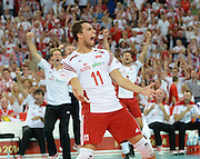 LODZ, POLAND - SEPTEMBER 16: Fabian Drzyzga of Poland celebrates after winning a point during the FIVB World Championships match between Poland and Brazil on September 16, 2014 in Lodz, Poland. (Photo by Piotr Hawalej)