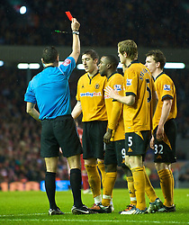 LIVERPOOL, ENGLAND - Saturday, December 26, 2009: Wolverhampton Wanderers' Stephen Ward is shown the red card, and sent off, by referee Andre Marriner during the Premiership match at Anfield. (Photo by: David Rawcliffe/Propaganda)