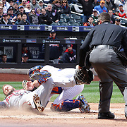 The Braves score a run in the second inning when umpires ruled that Mets catcher Anthony Recker did not provide a clear lane for A.J. Pierzynski to score at home plate. Pierzynski was originally ruled out, but Braves manager Fredi Gonzalez challenged the call, and the ruling was overturned after a review during the New York Mets Vs Atlanta Braves MLB regular season baseball game at Citi Field, Queens, New York. USA. 23rd April 2015. Photo Tim Clayton