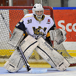 WHITBY, ON - Dec 9: Ontario Junior Hockey League game between Trenton Golden Hawks and Whitby Fury. Tyler Feaver #31 of the Whitby Fury during third period game action..(Photo by Shawn Muir / OJHL Images)