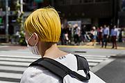 Tokyo, April 26 2016 - Issey Miyake world in Tokyo. Harajuku fashionable youth in Takeshita Dori.