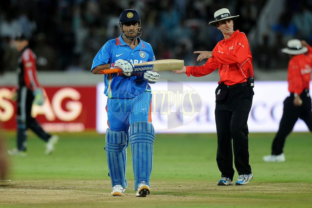 Mahendra Singh Dhoni captain of India walks back after the innings during the first One Day International ( ODI ) match between India and England held at the Rajiv Gandhi International Stadium, Hyderabad on the 14th October 2011..Photo by Pal Pillai/BCCI/SPORTZPICS