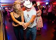 Hunter Magness (right) leads Janna Horn (left) around the dance floor at the Broken Spoke dance hall on Thurs., Sept. 28, 2012.<br /> Ashley Landis FOR AMERICAN STATESMAN