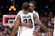 ST. LOUIS, MO - MARCH 26: Korie Lucious #34 and Durrell Summers #15 of the Michigan State Spartans celebrate at the end of the game against the Northern Iowa Panthers during the Midwest regional semi-final of the NCAA men's basketball tournament at the Edward Jones Dome on March 26, 2010 in St. Louis, Missouri. Michigan State advanced with a 59-52 win. (Photo by Joe Robbins)