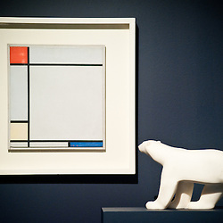 London,UK - 7 June 2013: a work by Piet Mondrian entitled ?Composition with red, Yellow amd Blue, 1927) (Est. £4.5-6.5 million) stands next to a white marble sculpture by Francois Pompon during the preview of this summer auction estimated at £100 million.
