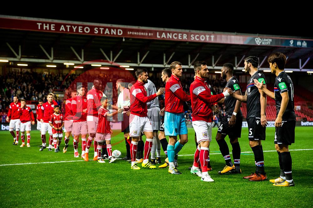 Bailey Wright of Bristol City greets James Tomkins of Crystal Palace - Rogan/JMP - 24/10/2017 - Ashton Gate Stadium - Bristol, England - Bristol City v Crystal Palace - Carabao Cup Round of 16.