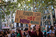 "El Planeta esta mas hot que mi novio imaginario. ""The planet is hotter than my imaginary boyfriend"" Climate Strike, Fridays for the Future, September 28, 2019. 20,000 people took to the streets, joining more than 7 million worldwide calling for climate action.  At <br /> Jardins de Salvador Espriu<br /> , Gracia, and Diagonal, Barcelona"