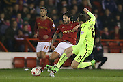 Brighton central midfielder, Dale Stephens (6) slides in on Nottingham Forest midfielder Henri Lansbury (10) during the Sky Bet Championship match between Nottingham Forest and Brighton and Hove Albion at the City Ground, Nottingham, England on 11 April 2016.
