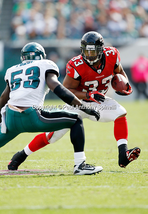 Atlanta Falcons running back Michael Turner (81) while avoiding a tackle attempt by Philadelphia Eagles linebacker Moise Fokou (53) during the NFL week 6 football game against the Philadelphia Eagles on Sunday, October 17, 2010 in Philadelphia, Pennsylvania. The Eagles won the game 31-17. (©Paul Anthony Spinelli)