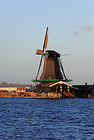 Zaanse Schans, just outside of Amsterdam, Holland, is famous for its running windmills and a popular tourist attraction.