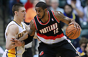 March 13, 2012; Indianapolis, IN, USA; Portland Trail Blazers power forward LaMarcus Aldridge (12) dribbles Indiana Pacers power forward Tyler Hansbrough (50) at Bankers Life Fieldhouse. Indiana defeated Portland 92-75. Mandatory credit: Michael Hickey-US PRESSWIRE