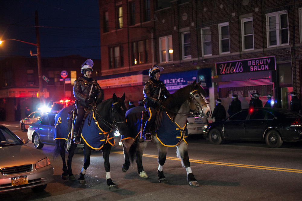 Police officers ride horses down Church Avenue near a memorial for Kimani Gray at E 55 St and Church Ave in Brooklyn, NY on Sunday, March 17, 2013...Photograph by Andrew Hinderaker