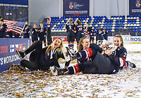 DMITROV, RUSSIA - JANUARY 13: USA's Taylor Heise #23 holding the championship trophy along with Madeline Wethington #4 and Makayla Pahl #29 celebrating after a 9-3 gold medal game win against Sweden at the 2018 IIHF Ice Hockey U18 Women's World Championship. (Photo by Steve Kingsman/HHOF-IIHF Images)