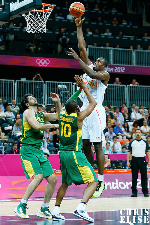 06 August 2012: Spain Serge Ibaka goes for the skyhook over Brazil Leandrinho Barbosa during 88-82 Team Brazil victory over Team Spain, during the men's basketball preliminary, at the Basketball Arena, in London, Great Britain.
