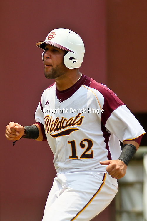 June 04, 2011; Tallahassee, FL, USA; Bethune-Cookman Wildcats third baseman reacts after scoring during the sixth inning of the Tallahassee regional of the 2011 NCAA baseball tournament against the UCF Knights at Dick Howser Stadium. Mandatory Credit: Derick E. Hingle
