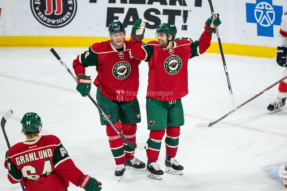 Dec 13, 2016; Saint Paul, MN, USA; Minnesota Wild forward Mikko Koivu (9) and forward Jason Zucker (16) against the Florida Panthers at Xcel Energy Center. The Wild defeated the Panthers 5-1. Mandatory Credit: Brace Hemmelgarn-USA TODAY Sports