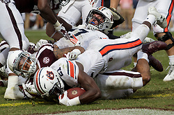 Auburn running back Kerryon Johnson (21) climbs over Texas A&M defensive back Larry Pryor (11) to cross the goal line for a touchdown during the third quarter of an NCAA college football game on Saturday, Nov. 4, 2017, in College Station, Texas. (AP Photo/Sam Craft)