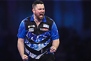 Luke Humphries hits a double and wins a leg during the PDC William Hill Darts World Championship at Alexandra Palace, London, United Kingdom on 13 December 2019.