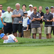 Rory McIlroy chips out of the bunker on the second hole  during the third round of theThe Barclays Golf Tournament at The Ridgewood Country Club, Paramus, New Jersey, USA. 23rd August 2014. Photo Tim Clayton