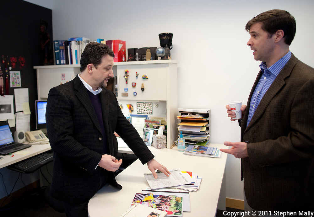 Jon Edwards (from left), Associate Dean of Admission and Coordinator of International Admission, and Seth Allen, Dean of Admission and Financial Aid, look over a stack of student's personal catalogue at Grinnell College in Grinnell, Iowa on Tuesday February 1, 2011.