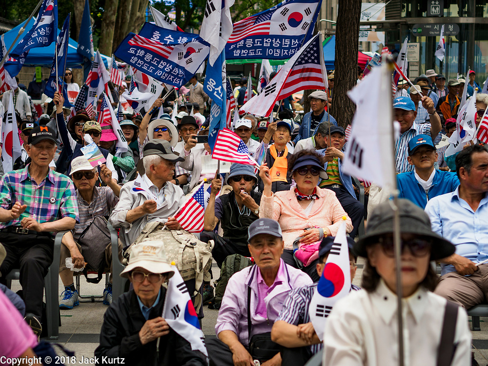 09 JUNE 2018 - SEOUL, SOUTH KOREA: The crowd at a pro-American rally in downtown Seoul. Participants said they wanted to thank the US for supporting South Korea and they hope the US will continue to support South Korea. Many were also opposed to ongoing negotiations with North Korea because they don't think Kim Jong-un can be trusted to denuclearize or to not attack South Korea.     PHOTO BY JACK KURTZ