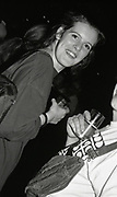 Crowd member enjoying the 808 state gig with a drink, Piccadilly venue, Manchester, 1989.