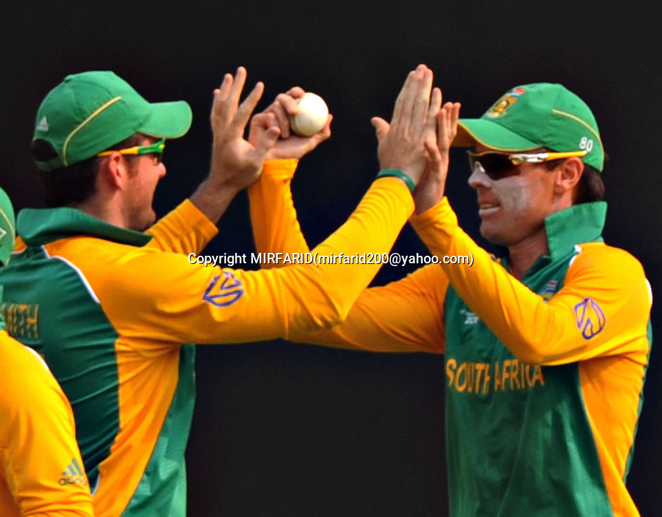 Graeme Smith and Johan Botha celebrate the wicket of Martin Gupthill during the ICC Cricket World Cup quarter final match between South Africa and New Zealand held at the Shere Bangla National Stadium, Mirpur, Bangladesh on the 25 March 2011<br />