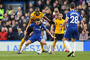 Wolverhampton Wanderers defender Willy Boly (15) battles for possession with Chelsea midfielder Pedro (11) during the Premier League match between Chelsea and Wolverhampton Wanderers at Stamford Bridge, London, England on 10 March 2019.