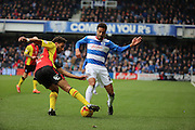 Birmingham City defender, Ryan Shotton (32)  battling for the ball with Queens Park Rangers defender, James Perch (24) during the Sky Bet Championship match between Queens Park Rangers and Birmingham City at the Loftus Road Stadium, London, England on 27 February 2016. Photo by Matthew Redman.