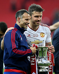Michael Carrick of Manchester United and Assistant Manager Ryan Giggs with The FA Cup  - Mandatory by-line: Robbie Stephenson/JMP - 21/05/2016 - FOOTBALL - Wembley Stadium - London, England - Crystal Palace v Manchester United - The Emirates FA Cup Final