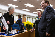 Ledell Zellers, Alder, District 2, left, smiles as she opens a parting gift before the swearing in ceremony for Satya Rhodes-Conway and newly elected Alders at the City County Building in Madison, WI on Tuesday, April 16, 2019.